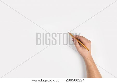 Close-up Hand Writing With A Pencil, Brown Wooden Pencil In Hand, Isolated On White Background With