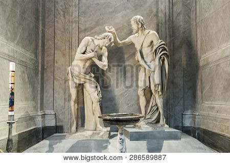Rome, Italy - March 27, 2018:  Sculptural Group The Baptism Of Christ Inside Basilica San Giovanni D