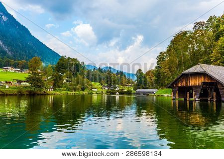 The lake is surrounded by high mountains. Mountain Lake is a fabulous beauty in Bavaria. Koenigssee - the cleanest lake in Germany. The concept of active, ecological and photo tourism