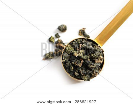 Scoop With Tie Guan Yin Oolong Tea On White Background, Top View