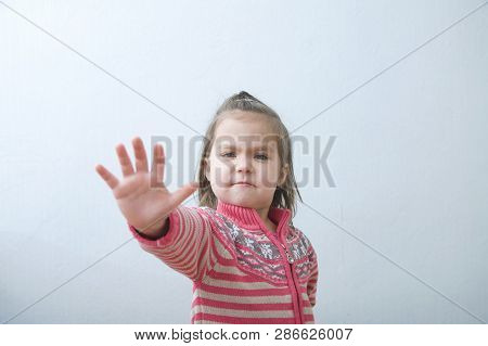 Stop Sign, Childs Palm Saying Stop With Hands In Front Of Himself. Suspend Of Constraint On Children