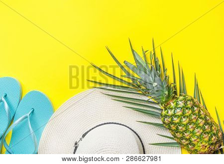 Ripe Pineapple On Green Palm Leaf White Straw Hat Blue Slippers On Bright Yellow Solid Background. S