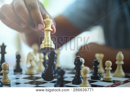 Hand Of Businessman Playing Chess Game,competition Success Play,management Or Leadership Concept.
