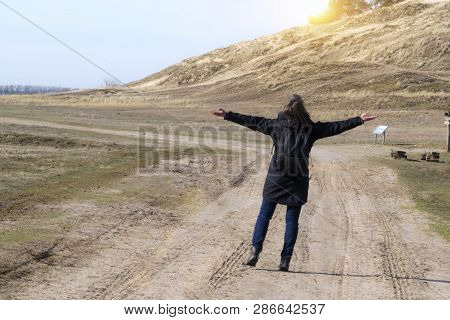 Caucasian Young Woman In The Empty Road