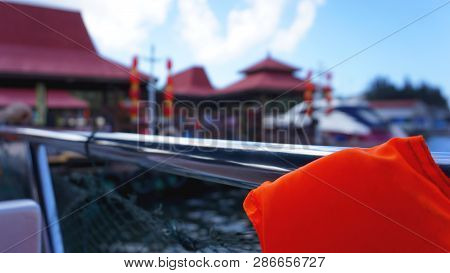Life Jacket And Net On Boat. Safety Net On Boat. Ropes On Boat. Safety Ropes And Blue Sea. Waves On