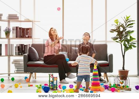 Asian Family, Happy Time At Home, Young Beautiful Mother And Young Son Wearing Eyes Glasses Sitting