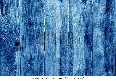 Weathered Wooden Fence In Navy Blue Color. Abstract Background And Texture For Design.