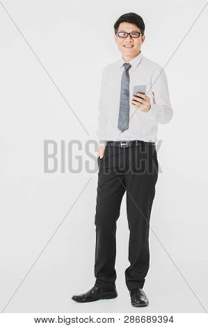 Full Length Portrait Of Middle Aged, Handsome, Asian, Businessman, In White Shirt, Striped Tie Black