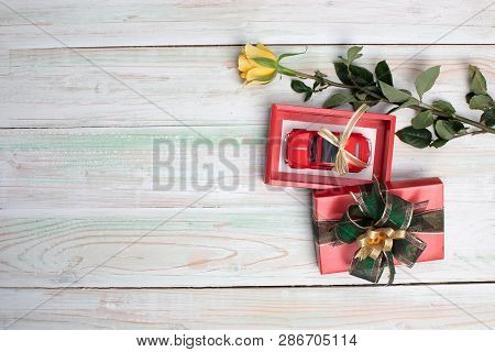 Valentines Day, Love, Wedding, Celebration, Gift Concept, Red Toy Car With Golden Ribbon In Opened R
