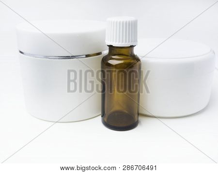 Realistic Essential Oil Brown Bottle And White Containers Mock Up Bottle. Cosmetic Vial, Flask, Flac