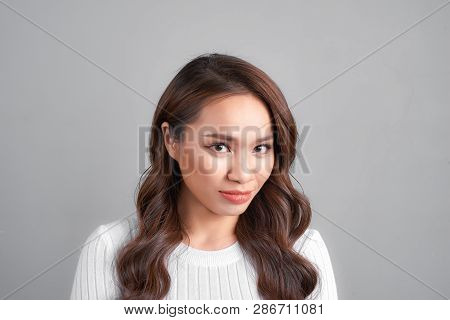 Young Beautiful Arrogant And Moody Woman Showing Negative Feeling And Contempt Facial Expression Iso