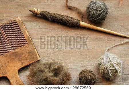 Traditional Female Craft Tools On Dark Wooden Background
