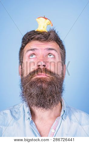 Live Target Concept. Man Handsome Hipster Long Beard Almost Eaten Apple Stump On Head As Target. Hip