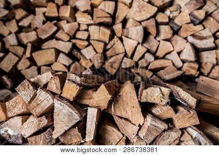 Birch Firewood. Broken Ax Birch Logs Are In Disarray.
