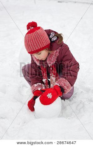 The Little Girl Fashions Snowman