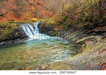 Small Forest Waterfall In Autumn. Beautiful Nature Scenery On The River With Rocky Shore. Clear Wate