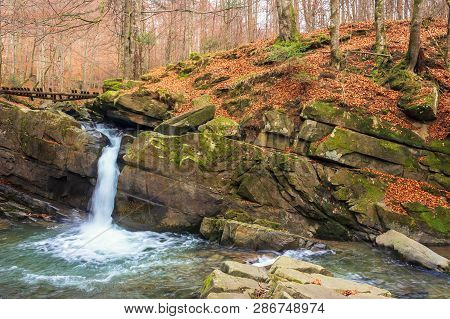 Small Forest Waterfall In Autumn. Beautiful Nature Scenery On The River. Clear Water, Fallen Foliage