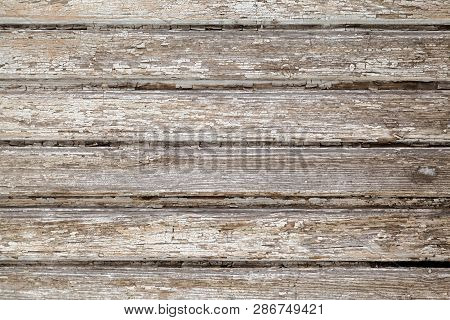 Wooden Stockade Background. Close-up Of Gray Wooden Planks Of The Old Wall. Wood Texture With Peelin