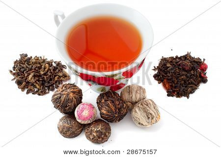 A cup of tea and various leaves for brewing tea poster