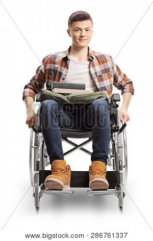 Full length portrait of a young disabled male student pushing his wheelchair isolated on white background