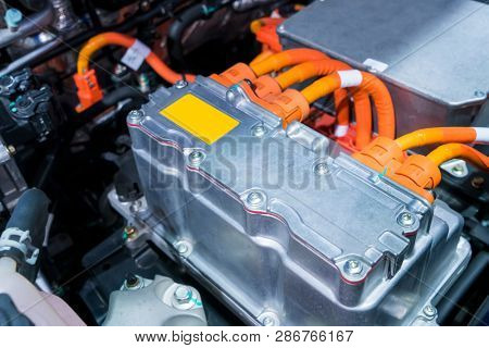 Battery and wire installed on electric system of eco car engine, Automotive part concept.