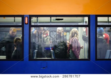 Mainz, Germany - September 27: Fans Of Football Club 1. Fsv Mainz 05 Stand And Sit In A Crowded Tram