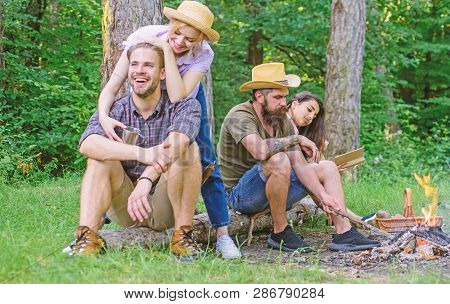 Friends Relaxing Near Campfire After Day Hiking Nature Background. Company Most Important Thing Orga