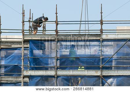 Gosford, New South Wales, Australia - December 1, 2018: Construction Worker On New Home Units Buildi