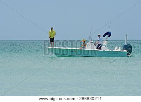 Holmes Beach, Anna Maria Island Fl / Usa - April 30, 2018: People Fishing From A Power Boat In The G