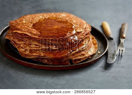 Homemade crepes with maple syrup