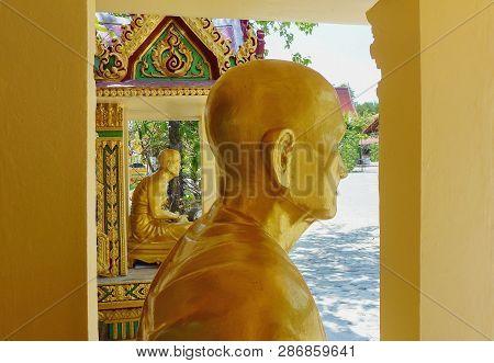 Two Sitting Golden Budhas Statues. Thailand Koh Samui