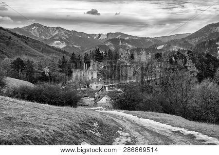 Ruins Of Castle Sklabina In Slovaka. Black And White Photo