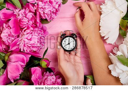 Florist At Work, Hands Of Woman Hold Alarm Clock.