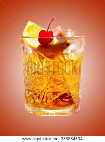 Classic Alcoholic Cocktail Godfather On An Orange Background Studio