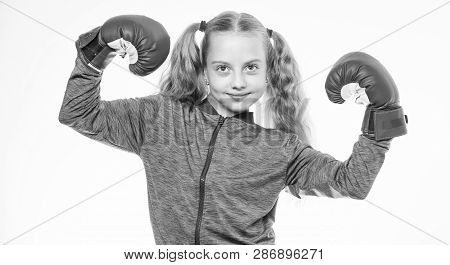 Girl child strong with boxing gloves posing on white background. She ready to defend herself. Sport upbringing for girls. Feminist movement. Self defence concept. Girl boxer knows how defend herself poster