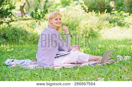 Woman With Laptop Sit Grass Meadow. Best Jobs To Work Remotely. Business Lady Freelance Work Outdoor
