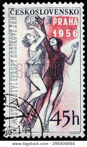 Luga, Russia - February 13, 2019: A Stamp Printed By Czechoslovakia Shows Two Women Basketball Playe