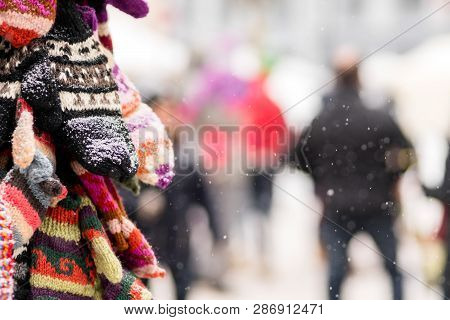 Gloves On Display On A Snowy Day In City Winter Fare. Christmas
