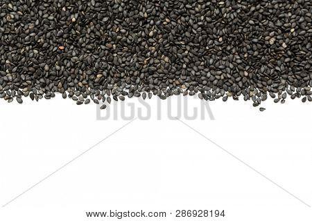 Black organic sesame seeds on white