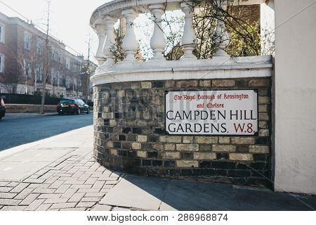 London, Uk - February 23, 2019: Campden Hill Gardens Street Name Sign On A Brick Wall In The Royal B
