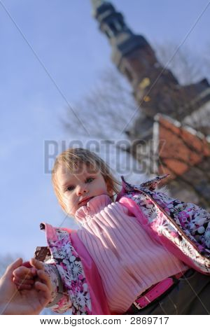 Little Girl Looking Down On Photographer Or Audience