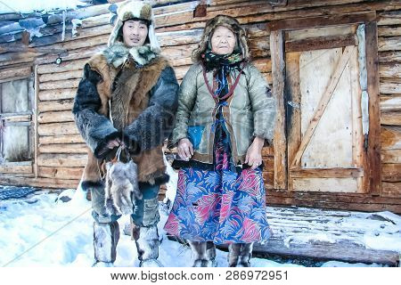 Bilibino, Russia - June 21, 2014: Chukchi Near Their Homes. The Local Population Of Chukotka