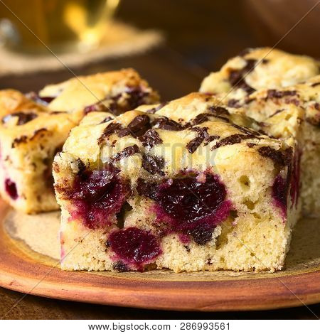 Cherry Blondie Or Blond Brownie Cake Baked With White And Dark Chocolate Pieces, Photographed With N