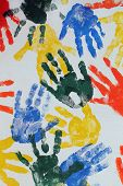 Colorful hand imprints in various shapes and patterns poster