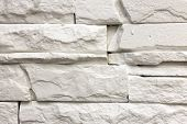 Close-up of white solid limestone wall or stone fence. Abstract copy space background, Bricklaying, construction and masonry concept. poster