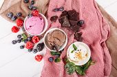 Chocolate Pink Fruit Vanilla Icecream Set Flat Lay. Three Different Ice Cream Dessert in Cup Top Down View. Various Gelato Color Mix with Sugar Powder. Variety Flavors Set of Soft Frozen Creamy Snack poster