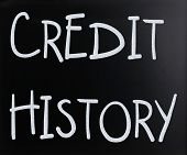 """Credit history"" handwritten with white chalk on a blackboard poster"