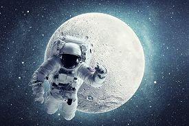 Astronaut In Outer Space Over Full Moon And Stars Background. Elements Of This Image Furnished By Na