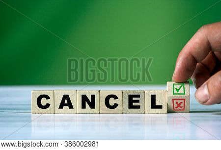 The Hand Turns The Wooden Cube And Changes The Word Cancel With Green Positive Tick Check Box And Re