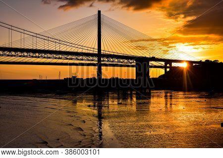 Forth Bridges At Sunset. The Forth Bridge Is A Cantilever Railway Bridge Near Edinburgh, Scotland.
